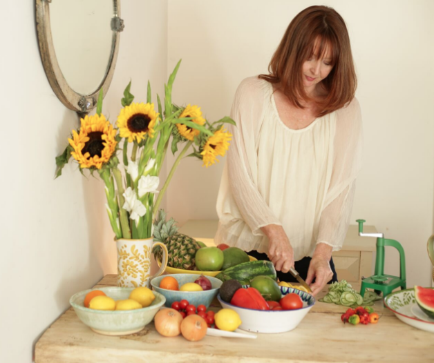 Holistic nutritionist Hanna Evans in London preparing fruit and vegetables