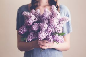 Acupuncture for hayfever relief for woman holding flowers