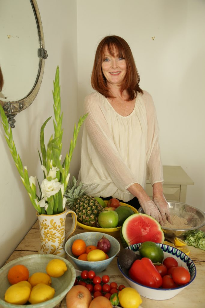 London holistic fertility nutritionist Hanna Evans preparing food for healthy pregnancy