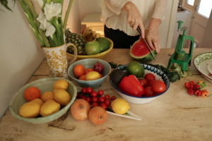 Holistic nutritionist Hanna Evans preparing fruit and vegetables